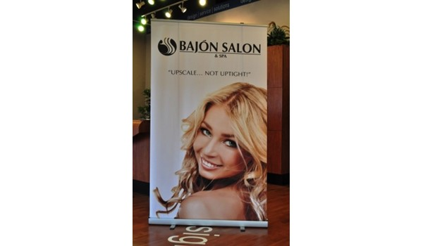 Eye catching displays are a great way to attract attention.  (Display banner by Signs Now Cincinnati for Bajon Salon, West Chester, OH)