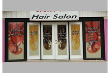 - Image360-Round-rock-window-lettering-hair-salon